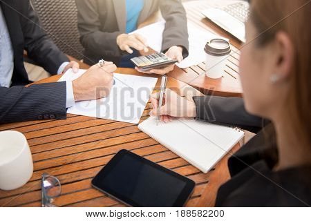 Business people having a meeting and working in coffee shop