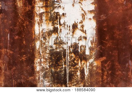 Old rusty metal background with white paint spots. Aged industrial background, plain steel surface with place for text. Grunge wallpaper.