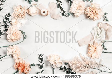 The florist desktop with working tools on white wooden background.
