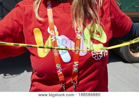 MONTREAL QUEBEC CANADA - 19 MAY 2017: Prevention girl with the logo Vive 375 on her t-shirt along Montreal streets during 375th birthday bash