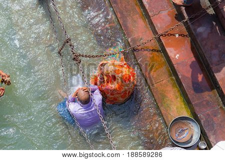 Haridwar, India - March 11, 2017: Unidentified People Bathing And Taking Ablutions In The Ganges Riv