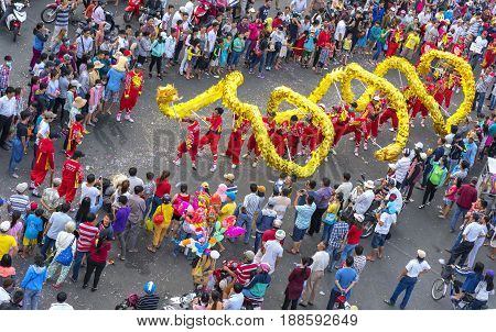 Binh Duong, Vietnam - February 11th, 2017: Dragon dance festival on the street with martial arts dragon winding control Practitioners of the Chinese Lantern Festival in Binh Duong, Vietnam
