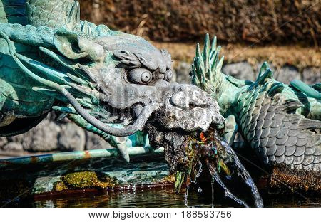 Detail Of Dragon Statue At Temple In Japan