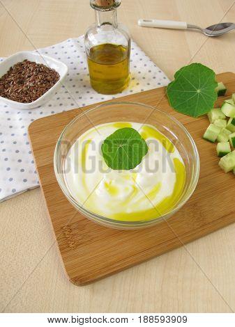 Yogurt with flaxseed oil in glass bowl