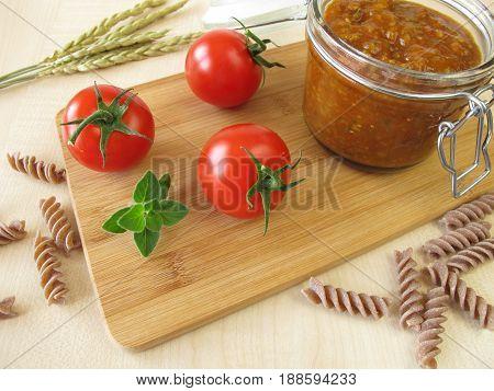 Homemade vegan green spelt bolognese in jar