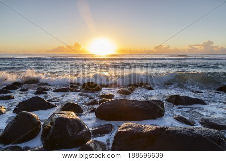 Sunrise and ocean tide coming over the rocks at Burleigh Heads Gold Coast