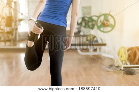Young Woman Stretching Legs Before Yoga Fitness Exercise Copy Space Area For Your Text Sunrise Jog W