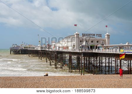 BRIGHTON EAST SUSSEX ENGLAND - JUNE 15 2013: View of Brighton pier and pebble beach