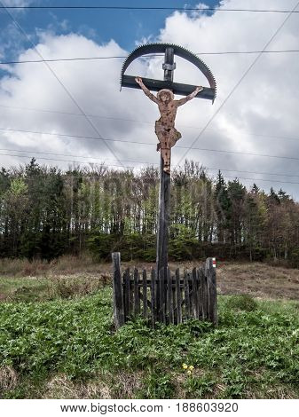 cross on mountain meadow with forest on the background on Lubochnianske sedlo in Velka Fatra mountains in Slovakia