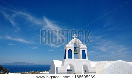 The white building in the town of Oia in Santorini, with beautiful views of the sea in the background