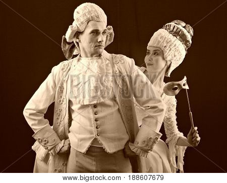 man and woman dancing in period costume and white wigs