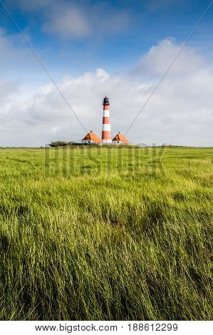Beautiful landscape with lighthouse at North Sea in Nordfriesland Schleswig-Holstein Germany