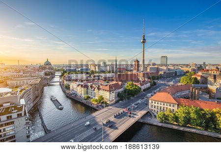 Aerial view of Berlin skyline with famous TV tower and Spree river in beautiful evening light at sunset Germany