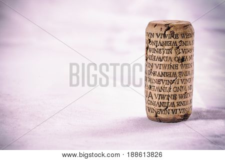 Wine cork with word wine in several languages. Isolated. Vintage filtered