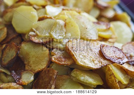 juicy fried potatoes in oil , street food