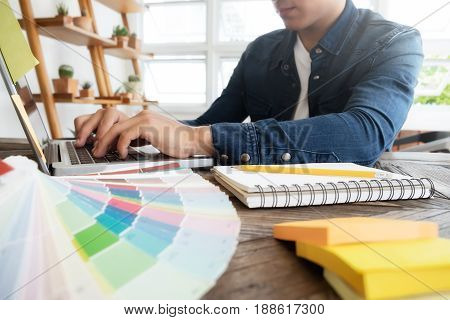 Freelance Photo Editor, Artist, Graphic Designer Working At Desk In Creative Office. Artist Drawing