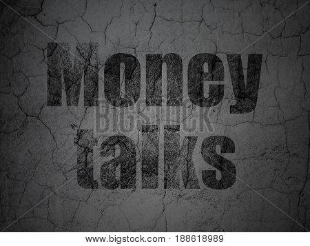 Business concept: Black Money Talks on grunge textured concrete wall background