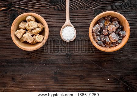 sugar in lumps for sweet food cooking on kitchen wooden table background top view mock up