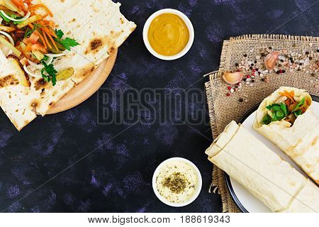 Shawarma Sandwich With Ingredients On Dark Background. Top View