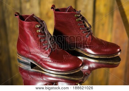 Man shoes burgundy color on the mirror