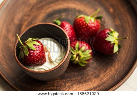Strawberry With Whipped Cream In Ceramic Plate
