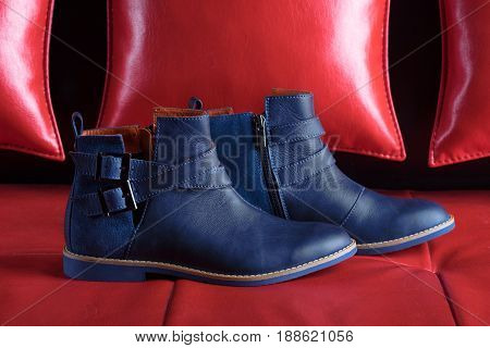 Fashion boots in modern color on red