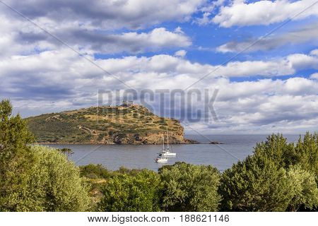 distant view on Temple of Poseidon at Cape Sounion, Greece