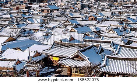 Roof of Jeonju traditional Korean village covered with snow Jeonju Hanok village in winter South Korea.