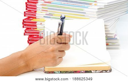 woman hand holding pen writting on book