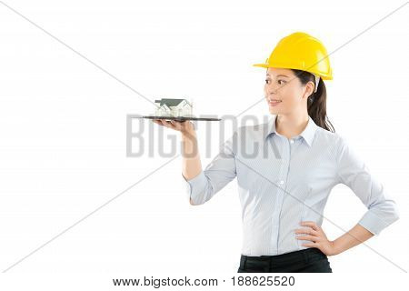 Young Woman Designer Showing House Model