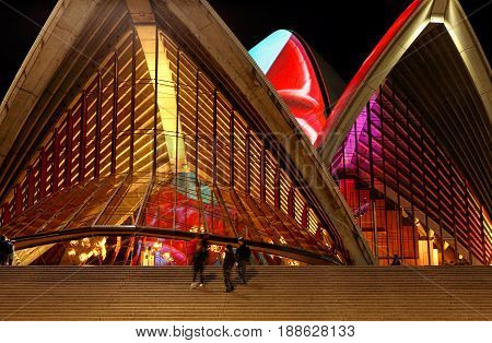 SYDNEY AUSTRALIA - MAY 29 2017; Views through the amber glass panels of the  Opera House illuminated roof tiles with animated designs during the Vivid Sydney annual public festival of light music and ideas.