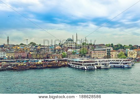ISTANBUL, TURKEY - MAY 1, 2017: Day view of the Suleymaniye Mosque and fishing boats in Eminonu, Istanbul, Turkey