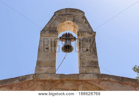 Bell over the blue sky in Greece.