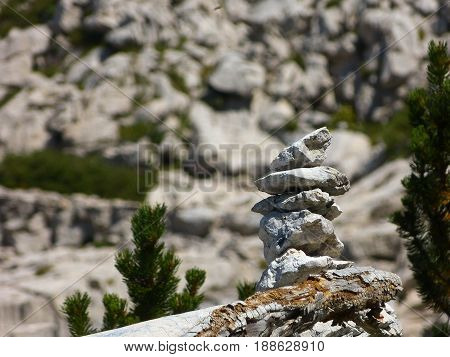 Stones cairn sign pointing in the right direction. Mountain trails. Conceptual image.