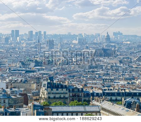 Top view of the part of Paris from the Montmartre hill against of a sky with clouds in the springtime