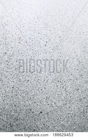 Very hight resolution. Wallpaper with airbrush effect. Black acrylic paint stroke texture on white paper. Scattered mud art. Macro image. Hand made grunge.