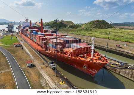 Panama Canal Panama - March 17 2014: Cargo Ship entering the Miraflores Lacks in the Panama Canal in Panama