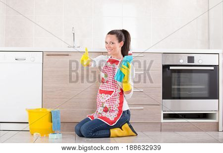Cleaning Lady Showing Bottle And Thumb Up
