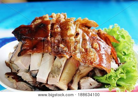 roasted pig is tasty on dish with sauce
