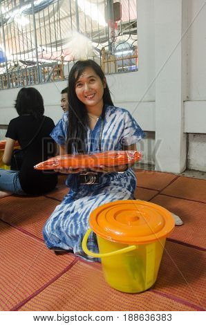 Thai Woman Offering Dedicated To Buddhist Monks At Wat Prommanee