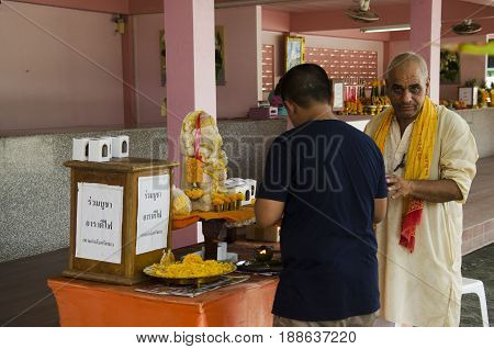 Indian Old Man Doing Merit And Ritual Hindu Style For Thai Man In Lord Ganesha Park
