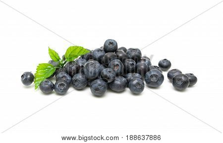 Ripe blueberries and green leaves close-up on a white background. Horizontal photo.