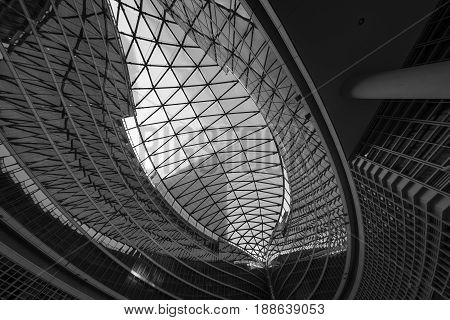 MILAN, ITALY - APRIL 8, 2017: Milan (Lombardy Italy): Palazzo Lombardia modern building hosting the government of the Region: the glass ceiling of the court. Black and white