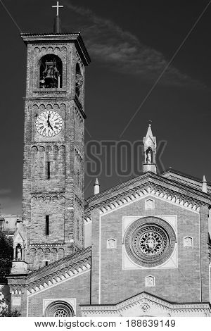 Milan (Lombardy Italy): exterior of the Sant'Eufemia church built from the 16th century in neo-Romanesque and neo-Gothic style. Black and white