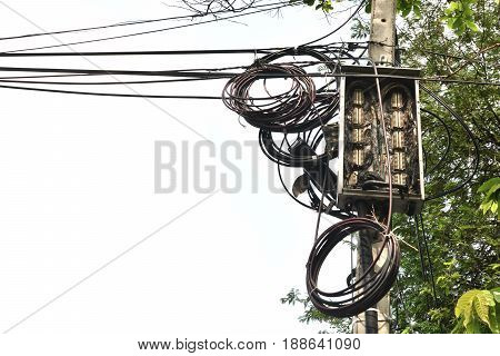 Electrical pole on sky, Electric pole with electric wire tangled,very messy electricity or telephone pole.