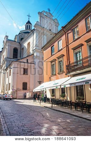 Street With Cafe And Dominican Church Of Holy Spirit Vilnius