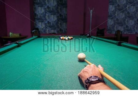 The Hand With The Cue.