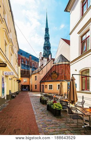 Street Cafe And Spire Of Saint Peter Church Riga