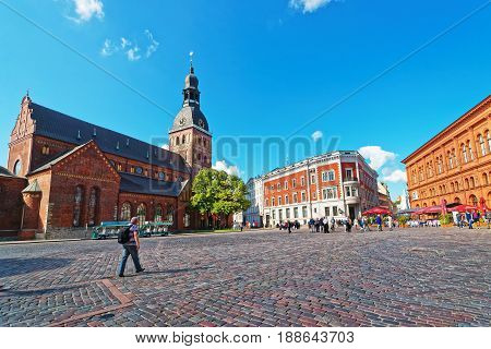 People On Dome Square With Riga Cathedral In Old Town