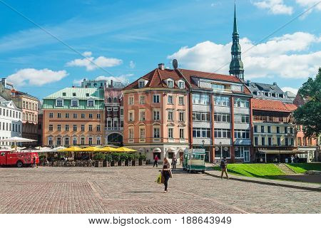 Square With People And Spire Of St Peter Church Riga